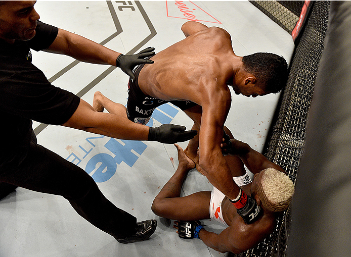 UBERLANDIA, BRAZIL - NOVEMBER 08:  Dhiego Lima of Brazil punches Jorge de Oliveira of Brazil in their welterweight bout during the UFC Fight Night at Sabiazinho Gymnasium on November 8, 2014 in Uberlandia, Brazil.  (Photo by Buda Mendes/Zuffa LLC/Zuffa LL