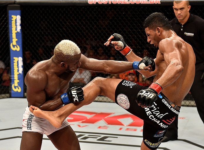 UBERLANDIA, BRAZIL - NOVEMBER 08:  Dhiego Lima of Brazil kicks Jorge de Oliveira of Brazil in their welterweight bout during the UFC Fight Night at Sabiazinho Gymnasium on November 8, 2014 in Uberlandia, Brazil.  (Photo by Buda Mendes/Zuffa LLC/Zuffa LLC