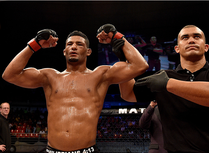 UBERLANDIA, BRAZIL - NOVEMBER 08:  Dhiego Lima of Brazil celebrates after his victory over Jorge de Oliveira of Brazil in their welterweight bout during the UFC Fight Night at Sabiazinho Gymnasium on November 8, 2014 in Uberlandia, Brazil.  (Photo by Buda