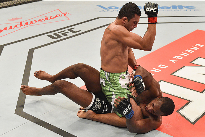 UBERLANDIA, BRAZIL - NOVEMBER 08:  Claudio Silva of Brazil punches Leon Edwards of England in their welterweight bout during the UFC Fight Night at Sabiazinho Gymnasium on November 8, 2014 in Uberlandia, Brazil.  (Photo by Buda Mendes/Zuffa LLC/Zuffa LLC