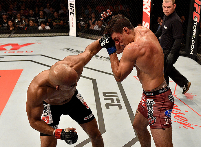 UBERLANDIA, BRAZIL - NOVEMBER 08:  Alan Jouban of the United States punches Warlley Alves of Brazil in their welterweight bout during the UFC Fight Night at Sabiazinho Gymnasium on November 8, 2014 in Uberlandia, Brazil.  (Photo by Buda Mendes/Zuffa LLC/Z
