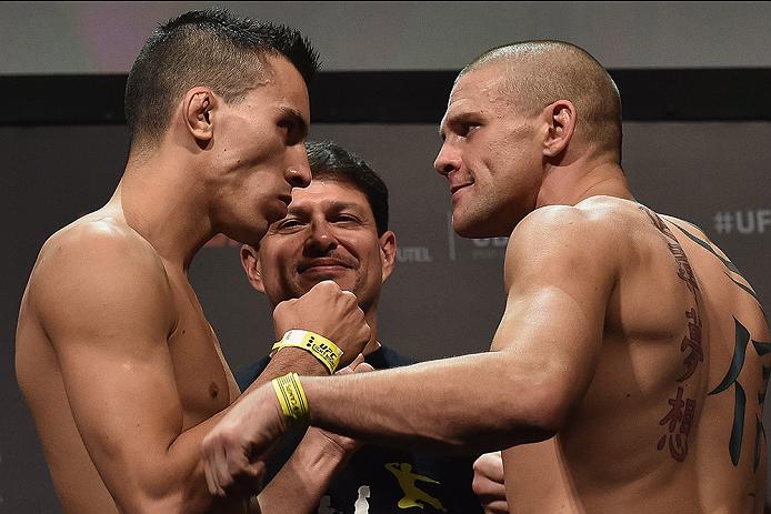 UBERLANDIA, BRAZIL - NOVEMBER 07:  (L-R) Opponents Thomas Almeida and Tim Gorman face off during the UFC Fight Night weigh-in at Sabiazinho Gymnasium on November 7, 2014 in Uberlandia, Brazil.  (Photo by Buda Mendes/Zuffa LLC/Zuffa LLC via Getty Images)