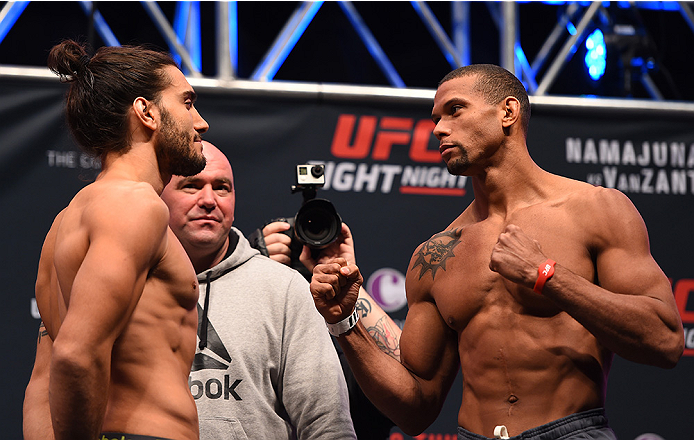 LAS VEGAS, NV - DECEMBER 09:  (L-R) Opponents Elias Theodorou of Canada and Thiago Santos of Brazil face off during the UFC Fight Night weigh-in inside MGM Grand Garden Arena on December 9, 2015 in Las Vegas, Nevada.  (Photo by Josh Hedges/Zuffa LLC/Zuffa