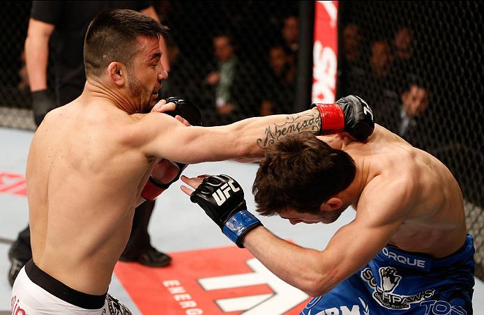 SAO PAULO, BRAZIL - MAY 31: (L-R) Pedro Munhoz punches Matt Hobar in their bantamweight fight during the UFC Fight Night event at the Ginasio do Ibirapuera on May 31, 2014 in Sao Paulo, Brazil. (Photo by Josh Hedges/Zuffa LLC/Zuffa LLC via Getty Images)