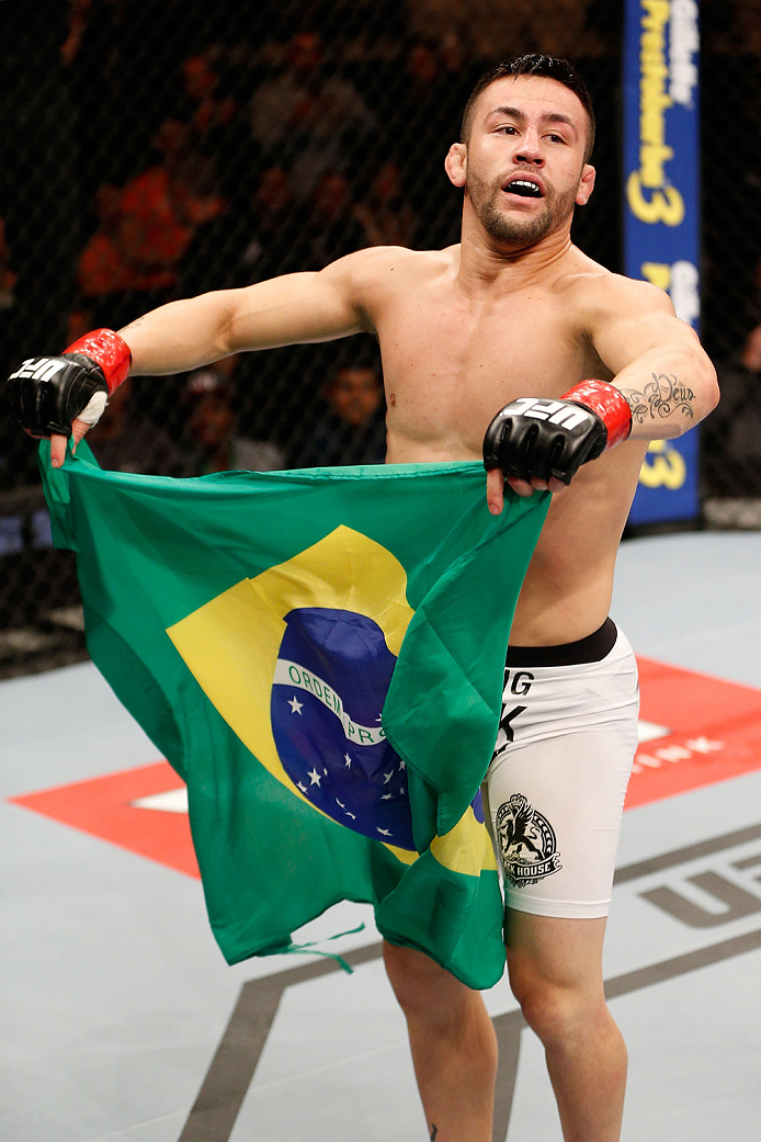 SAO PAULO, BRAZIL - MAY 31: Pedro Munhoz reacts after his TKO victory over Matt Hobar in their bantamweight fight during the UFC Fight Night event at the Ginasio do Ibirapuera on May 31, 2014 in Sao Paulo, Brazil. (Photo by Josh Hedges/Zuffa LLC/Zuffa LLC