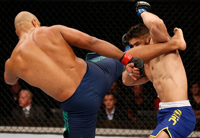 SAO PAULO, BRAZIL - MAY 31: (L-R) Marcos Rogerio de Lima kicks Richardson Moreira in their heavyweight fight during the UFC Fight Night event at the Ginasio do Ibirapuera on May 31, 2014 in Sao Paulo, Brazil. (Photo by Josh Hedges/Zuffa LLC/Zuffa LLC via