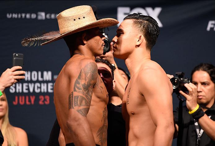 CHICAGO, IL - JULY 22:   (L-R) Opponents Alex Oliveira of Brazil and James Moontasri face off during the UFC weigh-in at the United Center on July 22, 2016 in Chicago, Illinois. (Photo by Josh HedgesZuffa LLC/Zuffa LLC via Getty Images)