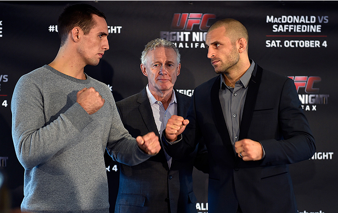 HALIFAX, NS - OCTOBER 2:  (L-R) Rory MacDonald and Tarec Saffiedine face off during the UFC Fight Night Ultimate Media Day on October 2, 2014 in Halifax, Nova Scotia, Canada. (Photo by Jeff Bottari/Zuffa LLC/Zuffa LLC via Getty Images)