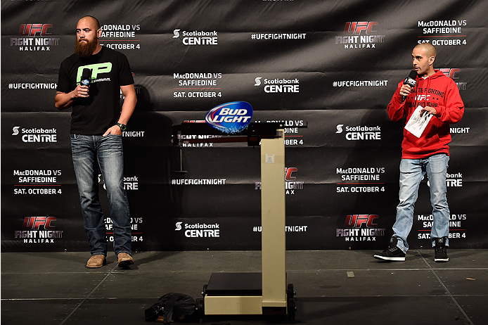 HALIFAX, NS - OCTOBER 3:  (L-R) Travis Browne and UFC announcer Jon Anik interact with fans during a Q&A session before the UFC Fight Night weigh-in at the Scotiabank Centre on October 3, 2014 in Halifax, Nova Scotia, Canada. (Photo by Jeff Bottari/Zuffa