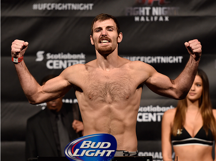 HALIFAX, NS - OCTOBER 3:  Jake Lindsey of the United States steps on the scale during the UFC Fight Night weigh-in at the Scotiabank Centre on October 3, 2014 in Halifax, Nova Scotia, Canada. (Photo by Jeff Bottari/Zuffa LLC/Zuffa LLC via Getty Images)