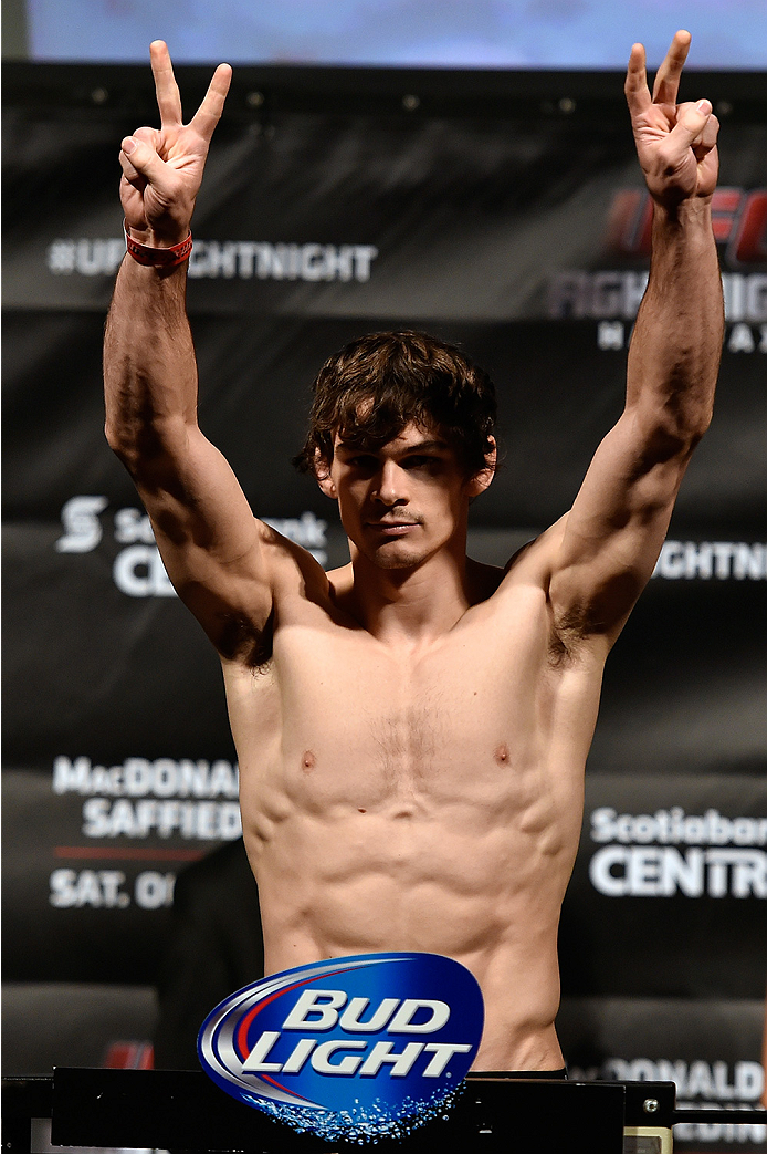 HALIFAX, NS - OCTOBER 3:  Olivier Aubin-Mercier of Canada steps on the scale during the UFC Fight Night weigh-in at the Scotiabank Centre on October 3, 2014 in Halifax, Nova Scotia, Canada. (Photo by Jeff Bottari/Zuffa LLC/Zuffa LLC via Getty Images)