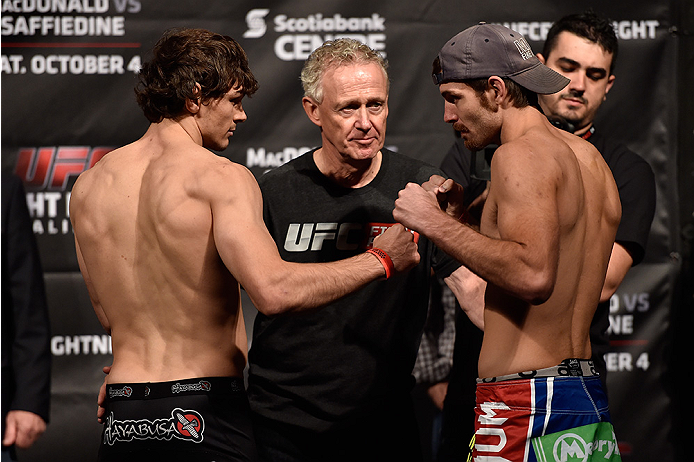 HALIFAX, NS - OCTOBER 3:  (L-R) Olivier Aubin-Mercier of Canada and Jake Lindsey of the United States face off during the UFC Fight Night weigh-in at the Scotiabank Centre on October 3, 2014 in Halifax, Nova Scotia, Canada. (Photo by Jeff Bottari/Zuffa LL