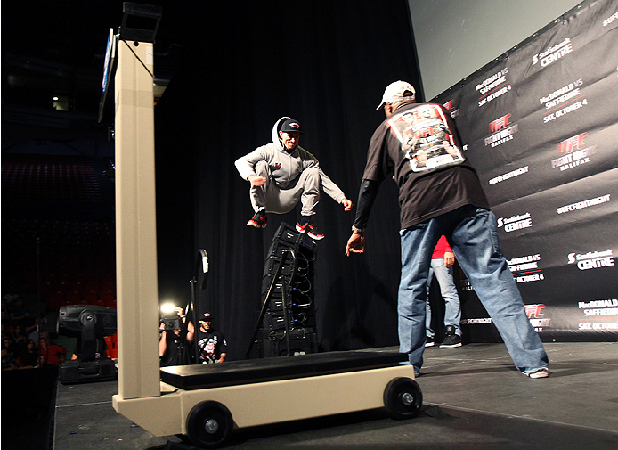 HALIFAX, NS - OCTOBER 3:  Nordine Taleb of Canada jumps on the stage during the UFC Fight Night weigh-in at the Scotiabank Centre on October 3, 2014 in Halifax, Nova Scotia, Canada. (Photo by Mike Roach/Zuffa LLC/Zuffa LLC via Getty Images)