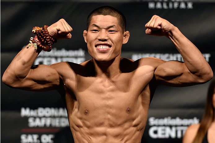 HALIFAX, NS - OCTOBER 3:  Li Jingliang of China steps on the scale during the UFC Fight Night weigh-in at the Scotiabank Centre on October 3, 2014 in Halifax, Nova Scotia, Canada. (Photo by Jeff Bottari/Zuffa LLC/Zuffa LLC via Getty Images)