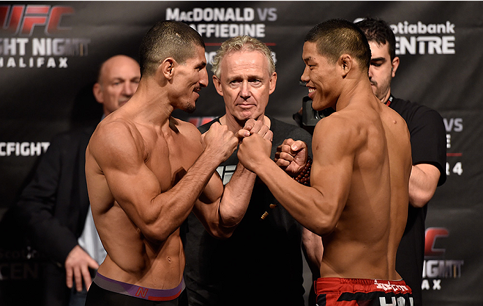 HALIFAX, NS - OCTOBER 3:  (L-R) Nordine Taleb and Li Jingliang face off during the UFC Fight Night weigh-in at the Scotiabank Centre on October 3, 2014 in Halifax, Nova Scotia, Canada. (Photo by Jeff Bottari/Zuffa LLC/Zuffa LLC via Getty Images)