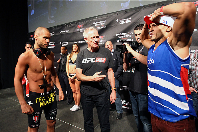 HALIFAX, NS - OCTOBER 3:  (L-R) Chad Laprise of Canada and Yosdenis Cedeno of Cuba prepare to face off during the UFC Fight Night weigh-in at the Scotiabank Centre on October 3, 2014 in Halifax, Nova Scotia, Canada. (Photo by Mike Roach/Zuffa LLC/Zuffa LL