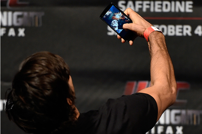HALIFAX, NS - OCTOBER 3:  Elias Theodorou of Canada takes a selfie onstage during the UFC Fight Night weigh-in at the Scotiabank Centre on October 3, 2014 in Halifax, Nova Scotia, Canada. (Photo by Jeff Bottari/Zuffa LLC/Zuffa LLC via Getty Images)