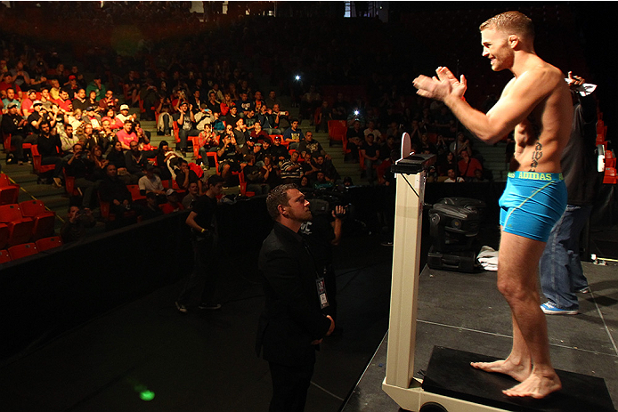 HALIFAX, NS - OCTOBER 3:  Bryan Caraway of the United States steps on the scale during the UFC Fight Night weigh-in at the Scotiabank Centre on October 3, 2014 in Halifax, Nova Scotia, Canada. (Photo by Mike Roach/Zuffa LLC/Zuffa LLC via Getty Images)