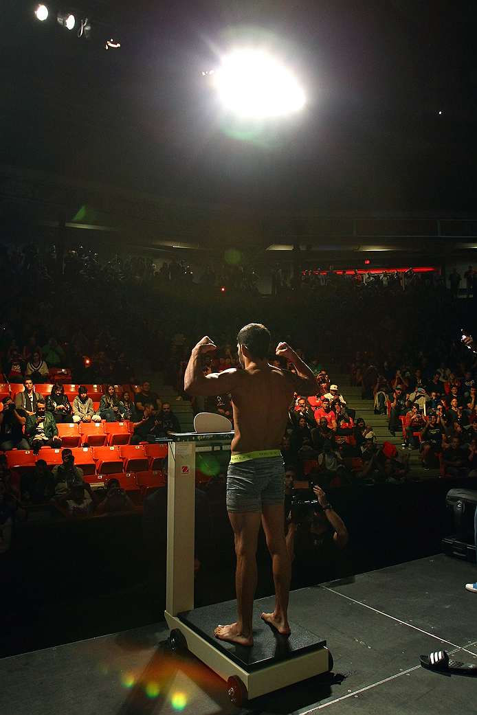HALIFAX, NS - OCTOBER 3:  Raphael Assuncao steps on the scale during the UFC Fight Night weigh-in at the Scotiabank Centre on October 3, 2014 in Halifax, Nova Scotia, Canada. (Photo by Mike Roach/Zuffa LLC/Zuffa LLC via Getty Images)