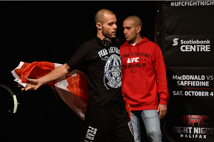 HALIFAX, NS - OCTOBER 3:  Chad Laprise of Canada walks onstage with the Canadian flag during the UFC Fight Night weigh-in at the Scotiabank Centre on October 3, 2014 in Halifax, Nova Scotia, Canada. (Photo by Jeff Bottari/Zuffa LLC/Zuffa LLC via Getty Ima