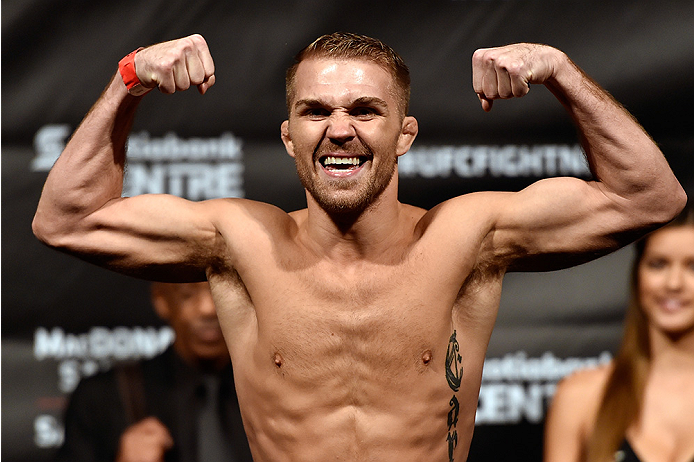 HALIFAX, NS - OCTOBER 3:  Bryan Caraway of the United States steps on the scale during the UFC Fight Night weigh-in at the Scotiabank Centre on October 3, 2014 in Halifax, Nova Scotia, Canada. (Photo by Jeff Bottari/Zuffa LLC/Zuffa LLC via Getty Images)