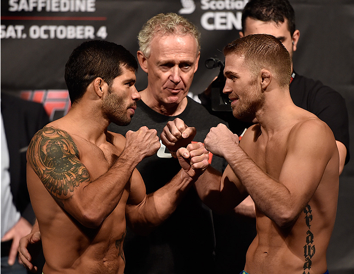 HALIFAX, NS - OCTOBER 3:  (L-R) Raphael Assuncao and Bryan Caraway face-off during the UFC Fight Night weigh-in at the Scotiabank Centre on October 3, 2014 in Halifax, Nova Scotia, Canada. (Photo by Jeff Bottari/Zuffa LLC/Zuffa LLC via Getty Images)