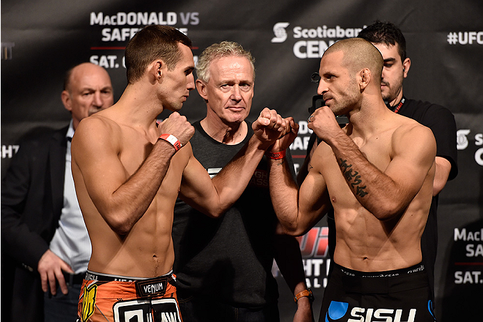 HALIFAX, NS - OCTOBER 3:  (L-R) Rory MacDonald and Tarec Saffiedine face off during the UFC Fight Night weigh-in at the Scotiabank Centre on October 3, 2014 in Halifax, Nova Scotia, Canada. (Photo by Jeff Bottari/Zuffa LLC/Zuffa LLC via Getty Images)