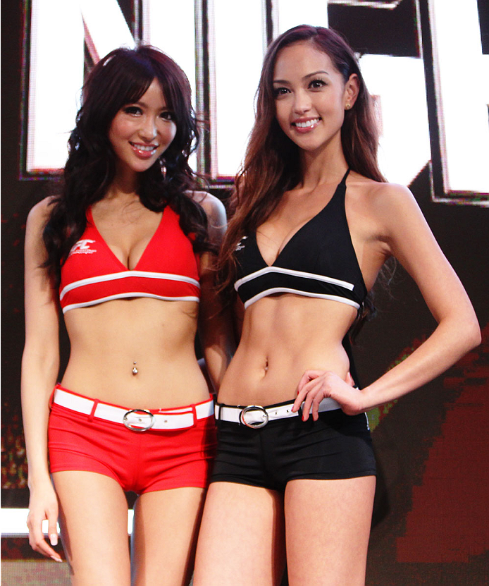 MACAU - FEBRUARY 28:  (L and R) UFC Octagon girls Azusa Nishigaki and Jessica Cambensy pose during the UFC weigh-in event at the Venetian Macau on February 28, 2014 in Macau. (Photo by Mitch Viquez/Zuffa LLC/Zuffa LLC via Getty Images)