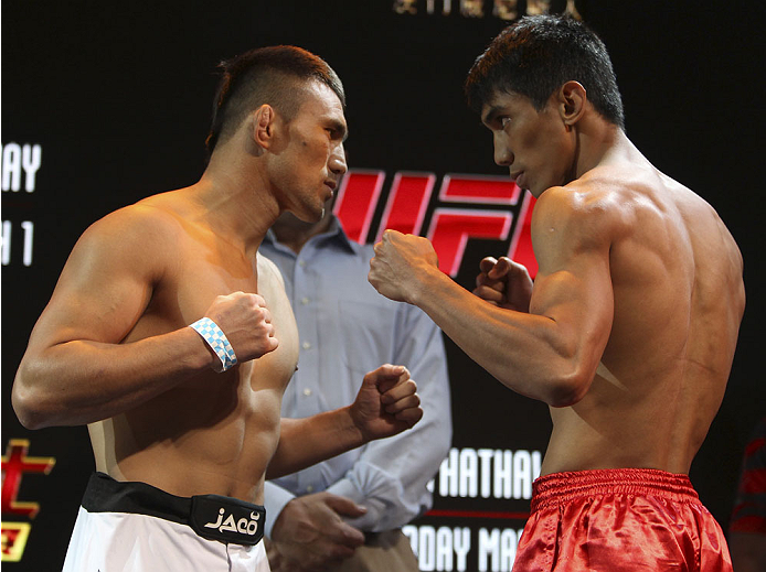 MACAU - FEBRUARY 28:  (L and R) Jumabieke Tuerxun and Mark Eddiva face off during the UFC weigh-in event at the Venetian Macau on February 28, 2014 in Macau. (Photo by Mitch Viquez/Zuffa LLC/Zuffa LLC via Getty Images)