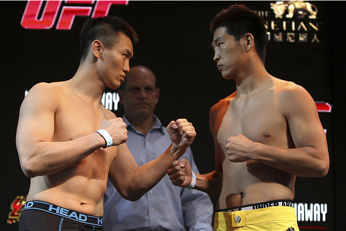 MACAU - FEBRUARY 28:  (L and R) Albert Cheng and Wang Anying face off during the UFC weigh-in event at the Venetian Macau on February 28, 2014 in Macau. (Photo by Mitch Viquez/Zuffa LLC/Zuffa LLC via Getty Images)