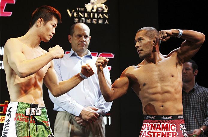 MACAU - FEBRUARY 28:  (L and R) Hatsu Hioki and Ivan Menjivar face off during the UFC weigh-in event at the Venetian Macau on February 28, 2014 in Macau. (Photo by Mitch Viquez/Zuffa LLC/Zuffa LLC via Getty Images)