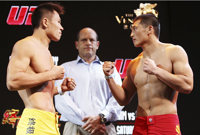 MACAU - FEBRUARY 28: (L and R) Wang Sai and Zhang Lipeng face off during the UFC weigh-in event at the Venetian Macau on February 28, 2014 in Macau. (Photo by Mitch Viquez/Zuffa LLC/Zuffa LLC via Getty Images)