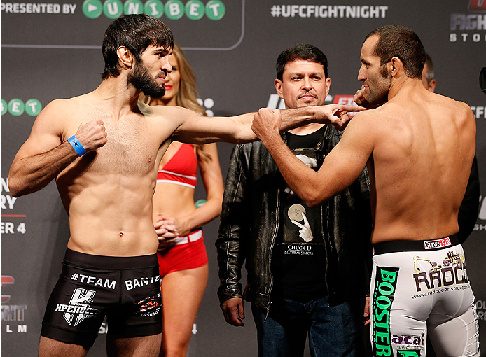 STOCKHOLM, SWEDEN - OCTOBER 03:  (L-R) Opponents Zubaira Tukhugov of Russia and Ernest Chavez face off during the UFC weigh-in at the Ericsson Globe Arena on October 3, 2014 in Stockholm, Sweden.  (Photo by Josh Hedges/Zuffa LLC/Zuffa LLC)