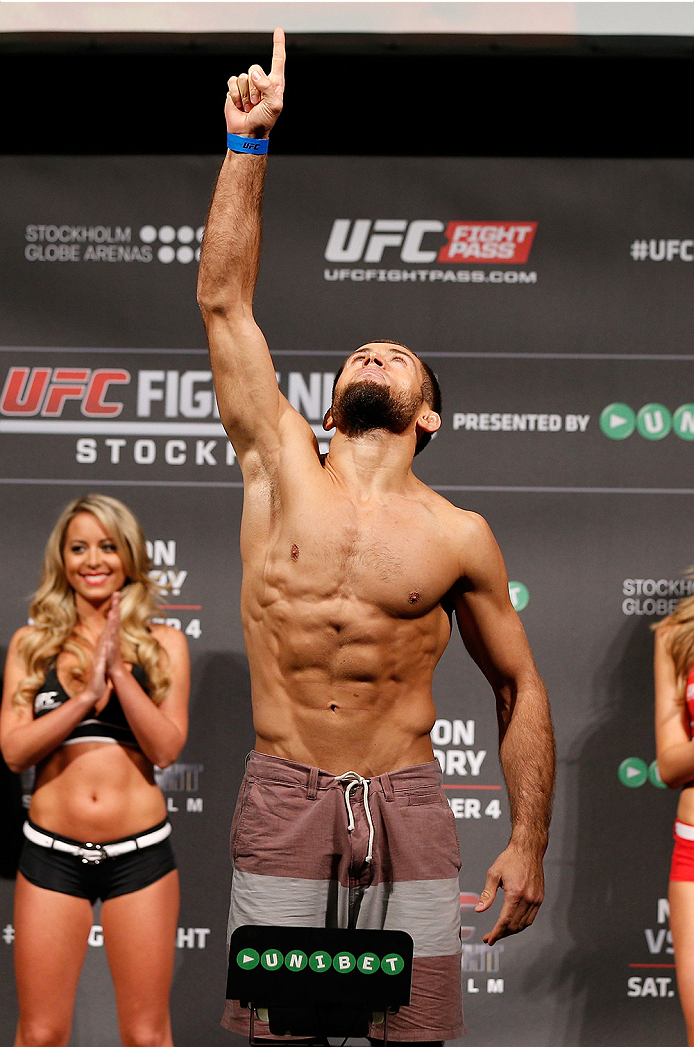 STOCKHOLM, SWEDEN - OCTOBER 03:  Mairbek Taisumov of Russia poses on the scale after weighing in during the UFC weigh-in at the Ericsson Globe Arena on October 3, 2014 in Stockholm, Sweden.  (Photo by Josh Hedges/Zuffa LLC/Zuffa LLC)