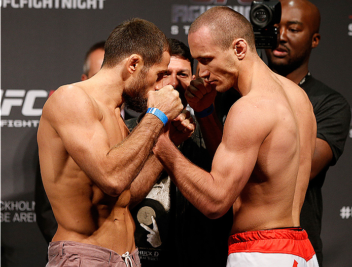 STOCKHOLM, SWEDEN - OCTOBER 03:  (L-R) Opponents Mairbek Taisumov of Russia and Marcin Bandel of Poland face off during the UFC weigh-in at the Ericsson Globe Arena on October 3, 2014 in Stockholm, Sweden.  (Photo by Josh Hedges/Zuffa LLC/Zuffa LLC)