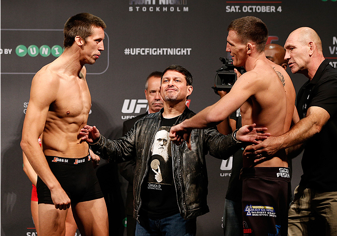 STOCKHOLM, SWEDEN - OCTOBER 03:  (L-R) Opponents Magnus Cedenblad of Sweden and Scott Askham of England face off during the UFC weigh-in at the Ericsson Globe Arena on October 3, 2014 in Stockholm, Sweden.  (Photo by Josh Hedges/Zuffa LLC/Zuffa LLC)