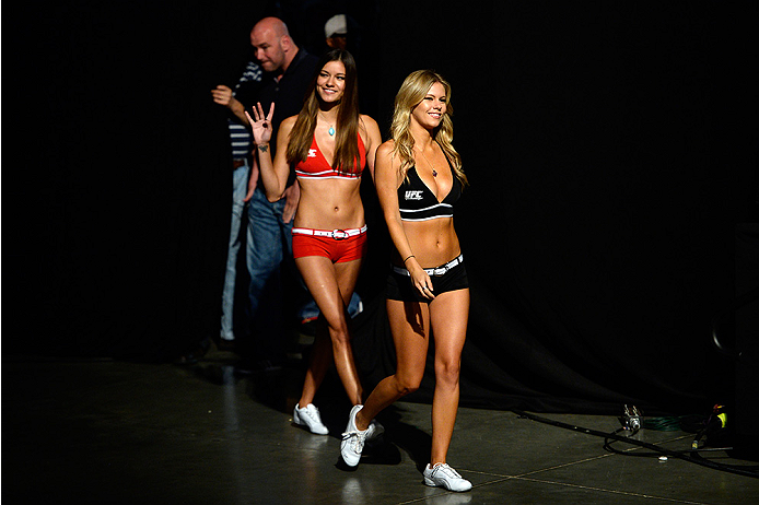 BANGOR, ME - AUG 15:  (R-L) UFC Octagon Girls Chrissy Blair and Vanessa Hanson walk to the stage during the UFC fight night weigh-in at the Cross Insurance Center on August 15, 2014 in Bangor, Maine. (Photo by Jeff Bottari/Zuffa LLC/Zuffa LLC via Getty Im