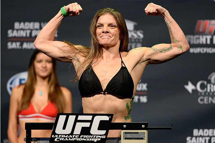 BANGOR, ME - AUG 15:  Lauren Murphy steps on the scale during the UFC fight night weigh-in at the Cross Insurance Center on August 15, 2014 in Bangor, Maine. (Photo by Jeff Bottari/Zuffa LLC/Zuffa LLC via Getty Images)