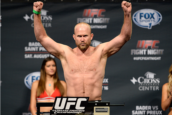 BANGOR, ME - AUG 15:  Tim Boetsch steps on the scale during the UFC fight night weigh-in at the Cross Insurance Center on August 15, 2014 in Bangor, Maine. (Photo by Jeff Bottari/Zuffa LLC/Zuffa LLC via Getty Images)