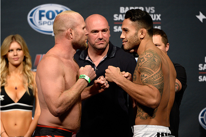 BANGOR, ME - AUG 15:  (L-R) Tim Boetsch and Brad Tavares face off during the UFC fight night weigh-in at the Cross Insurance Center on August 15, 2014 in Bangor, Maine. (Photo by Jeff Bottari/Zuffa LLC/Zuffa LLC via Getty Images)