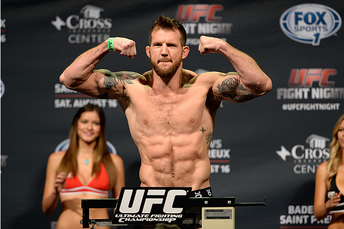 BANGOR, ME - AUG 15:  Ryan Bader steps on the scale during the UFC fight night weigh-in at the Cross Insurance Center on August 15, 2014 in Bangor, Maine. (Photo by Jeff Bottari/Zuffa LLC/Zuffa LLC via Getty Images)