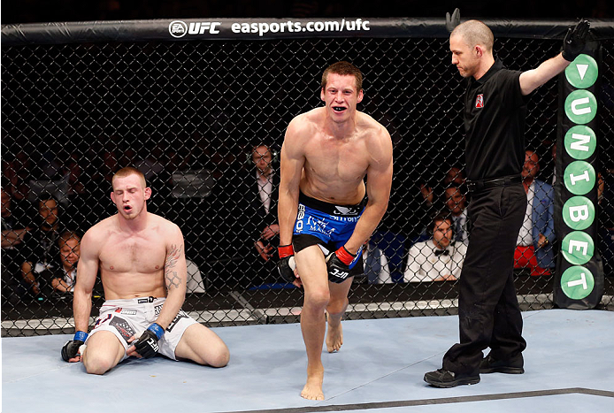 BERLIN, GERMANY - MAY 31:  Magnus Cedenblad (C) celebrates next to Krzysztof Jotko after winning the Krzysztof Jotko vs. Magnus Cedenblad  at UFC Fight Night Berlin event at O2 World on May 31, 2014 in Berlin, Germany. (Photo by Boris Streubel/Zuffa LLC/Z