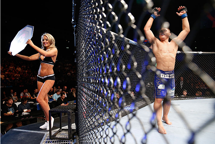 BERLIN, GERMANY - MAY 31:  Drew Dober (R) enters the octagon as Octagon Girl Carly Baker poses during the Drew Dober vs. Nick Hein  at UFC Fight Night Berlin event at O2 World on May 31, 2014 in Berlin, Germany. (Photo by Boris Streubel/Zuffa LLC/Zuffa LL