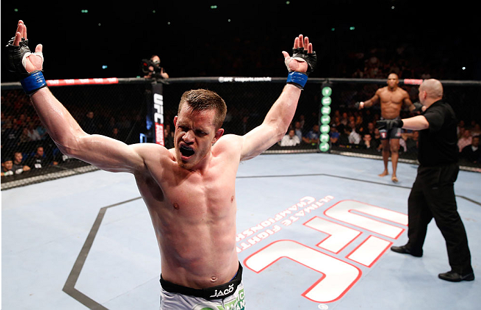 BERLIN, GERMANY - MAY 31:  C.B. Dollaway celebrates after winning the C.B. Dollaway vs. Francis Carmont match at UFC Fight Night Berlin event at O2 World on May 31, 2014 in Berlin, Germany. (Photo by Boris Streubel/Zuffa LLC/Zuffa LLC via Getty Images)
