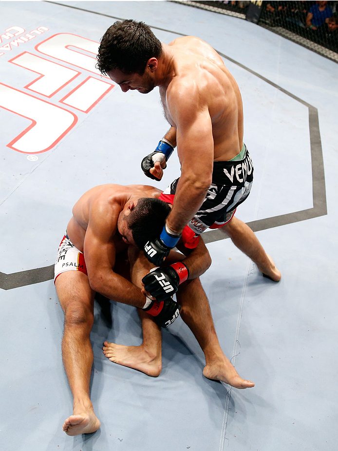 BERLIN, GERMANY - MAY 31:  Gegard Mousasi (R) fights Mark Munoz during the Gegard Mousasi vs. Mark Munoz match at UFC Fight Night Berlin event at O2 World on May 31, 2014 in Berlin, Germany. (Photo by Boris Streubel/Zuffa LLC/Zuffa LLC via Getty Images)