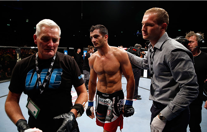 BERLIN, GERMANY - MAY 31:  Gegard Mousasi (C) leaves the octagon after winning the Gegard Mousasi vs. Mark Munoz match at UFC Fight Night Berlin event at O2 World on May 31, 2014 in Berlin, Germany. (Photo by Boris Streubel/Zuffa LLC/Zuffa LLC via Getty I