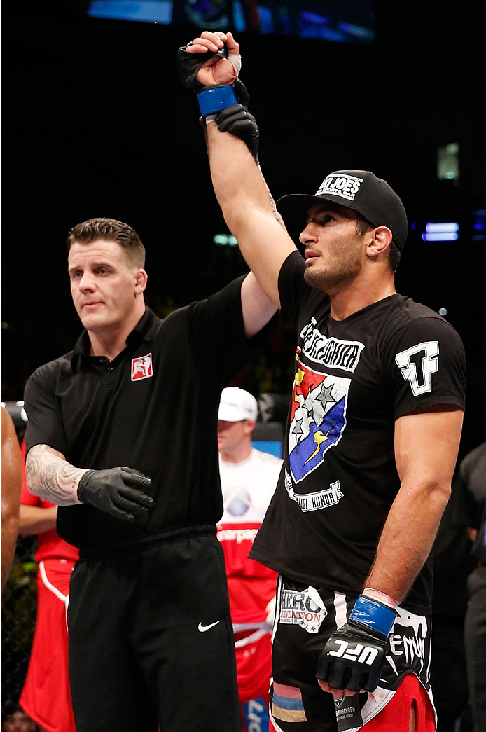 BERLIN, GERMANY - MAY 31:  Gegard Mousasi (R) celebrates after winning the Gegard Mousasi vs. Mark Munoz match at UFC Fight Night Berlin event at O2 World on May 31, 2014 in Berlin, Germany. (Photo by Boris Streubel/Zuffa LLC/Zuffa LLC via Getty Images)