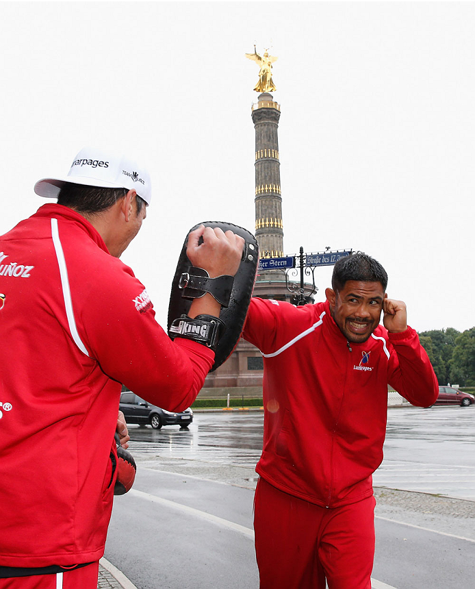 BERLIN, GERMANY - MAY 28:  Mark Munoz (R) holds a Guerillia open air training session for fans and media at Victoria Statue on May 28, 2014 in Berlin, Germany.  (Photo by Boris Streubel/Zuffa LLC/Zuffa LLC via Getty Images)
