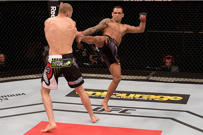 GOIANIA, BRAZIL - MAY 30:  Luiz Dutra of Brazil kicks Tom Breese of England in their welterweight UFC bout during the UFC Fight Night Condit v Alves at Arena Goiania on May 30, 2015 in Goiania.  (Photo by Buda Mendes/Zuffa LLC/Zuffa LLC via Getty Images)