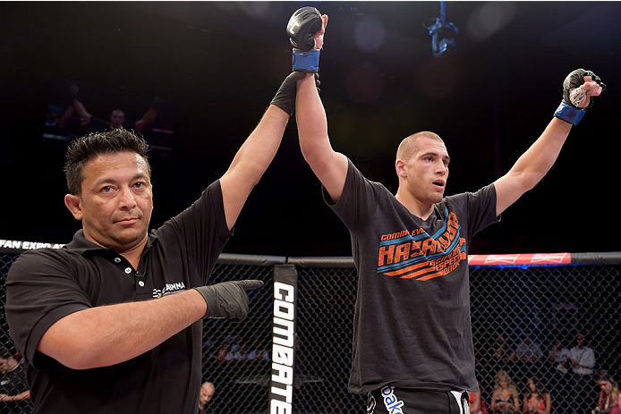 GOIANIA, BRAZIL - MAY 31: Tom Breese of England celebrates his victory over Luiz Dutra of Brazil in their welterweight UFC bout during the UFC Fight Night Condit v Alves at Arena Goiania on May 30, 2015 in Goiania.   (Photo by Buda Mendes/Zuffa LLC/Zuffa